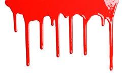 Röd genomblöt målarfärg Fotografering för Bildbyråer