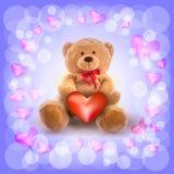 röd hjärta och en nallebjörn Arkivbilder