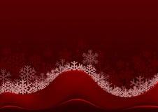 Röd jul som hälsar med snöflingor Royaltyfri Bild