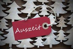 Röd juletikett med inaktiv tid för Auszeit hjälpmedel Royaltyfri Bild