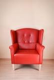 Röd läderfåtölj Royaltyfria Bilder