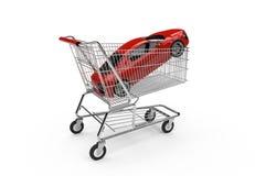 Röd lyxig sportbil i en shoppingkorg Arkivbild