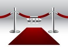 Röd matta med storgubbetecknet Royaltyfria Bilder