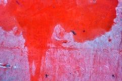 Röd metallisk yttersida som en texturerad bakgrund Royaltyfri Foto