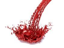 Röd målarfärgfärgstänk, på vit bakgrund Royaltyfria Bilder