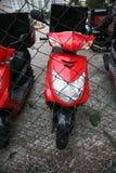 Röd motorcykel Arkivbild