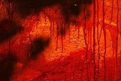 Röd nedfläckad vägg Fotografering för Bildbyråer
