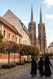 23rd October 2016: Three nuns walk down the road towards Wroclaw Stock Photo