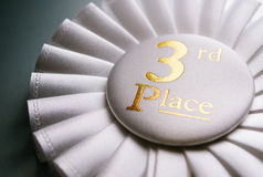 3rd place white winners rosette Stock Photos