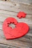 Röd pusselhjärta Fotografering för Bildbyråer