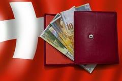 röd schweizisk plånbok för flaggafranc Royaltyfri Foto