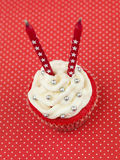 Röda muffinstearinljus Royaltyfria Foton