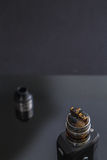RDA Tank atomizer with head disassembled. Vaporizers tank with DIY coil Stock Image