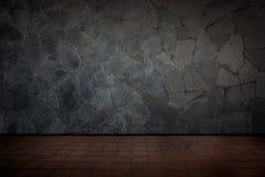 Röda tegelplattagolv och stenvägg Royaltyfri Foto