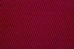 Rödbrunt material, en bakgrund Arkivfoton
