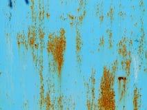 Rdza na błękitnym starym malującym metalu obrazy royalty free