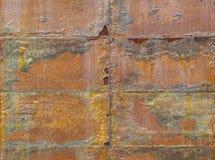 Rdzewiejący i gulgocze metali ściennych panel fotografia stock