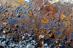 Rdzewieję pokrywał pęcherzami farba textured tło Fotografia Royalty Free