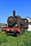 Rdzewiejąca stara parowa lokomotywa w na otwartym powietrzu muzeum fotografia stock