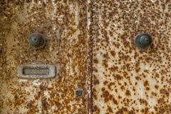 Rdzewiejący dwoisty drzwi Zdjęcia Stock