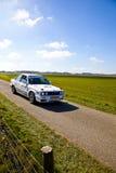 Reúna competir con de coche en paisaje holandés hermoso Imágenes de archivo libres de regalías