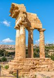 The re-assembled remains of the Temples of Castor and Pollux, located in the park of the Valley of the Temples in Agrigento, Sicil Royalty Free Stock Photography