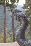Re del serpente, re della statua del naga nel fuoco scelto del tempio tailandese Fotografia Stock
