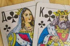 Re e regina dell'incrocio da una piattaforma di vecchie carte da gioco fotografia stock libera da diritti