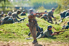 Re-enactment of the WWII battle. German Nazi soldiers attack Royalty Free Stock Image