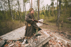 Re-enactor Dressed As Soviet Russian Red Army Infantry Soldier Of World War II Is Performing Mopping-up Operation With. Pribor, Belarus - April 24, 2016: Re Royalty Free Stock Image
