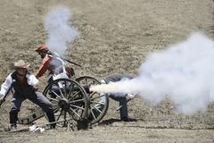 Re-enactors firing a cannon Stock Photography