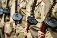 Re-enactos Dressed As Russian Soviet Soldiers Of World War II Holds. Sub-machine Guns Weapon In Hands And Standing Order Royalty Free Stock Photography