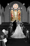 We're gone. Bride and groom run from church Stock Photography