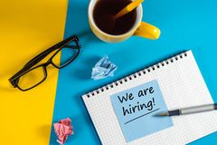 WE`RE HIRING CONCEPT at Human Resources Manager workplace. Job recruiting advertisement.  Royalty Free Stock Images
