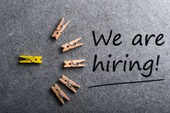 We`re Hiring, the phrase is written on dark background with little pins, Human resource concept, strategy, plan. Planning Royalty Free Stock Image