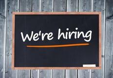 We're hiring written on blackboard Royalty Free Stock Image