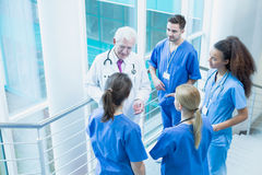 They're learning from the best. Students of medicine talking with a doctor in medical uniform stock photos