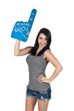 We're Number One. Pretty girl holding up a foam finger, cheering her team on Royalty Free Stock Photography