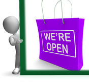We're Open Shopping Bag Sign Shows New Store Launch Royalty Free Stock Photography