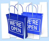 We're Open Shopping Bags Show Grand Opening or Launch Stock Images