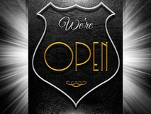 We're open sign on leather background Royalty Free Stock Photography