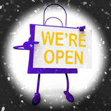 We're Open Sign on Shopping Bag Shows New Store Launch Or Openin Royalty Free Stock Photography