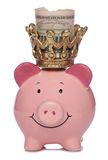 Re Piggybank con i dollari US Fotografia Stock