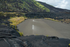 We're on a road to nowhere. A road to nowhere. Flowing lava has blocked this road on Hawaii's Big Island Stock Images