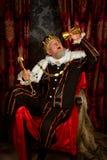 Re ubriaco con lo scettro Fotografia Stock Libera da Diritti