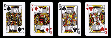 4 re in una fila - carte da gioco fotografia stock libera da diritti