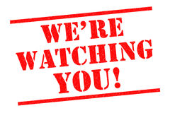 WE`RE WATCHING YOU!. WE'RE WATCHING YOU! red Rubber Stamp over a white background Royalty Free Stock Photo