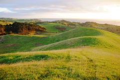 Área rural de montes verdes Fotografia de Stock