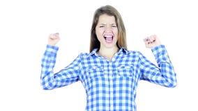 Reacción al éxito, mujer que anima y que celebra acertada, joven,