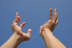 Reach. Pair of hands reaching skyward Royalty Free Stock Photo